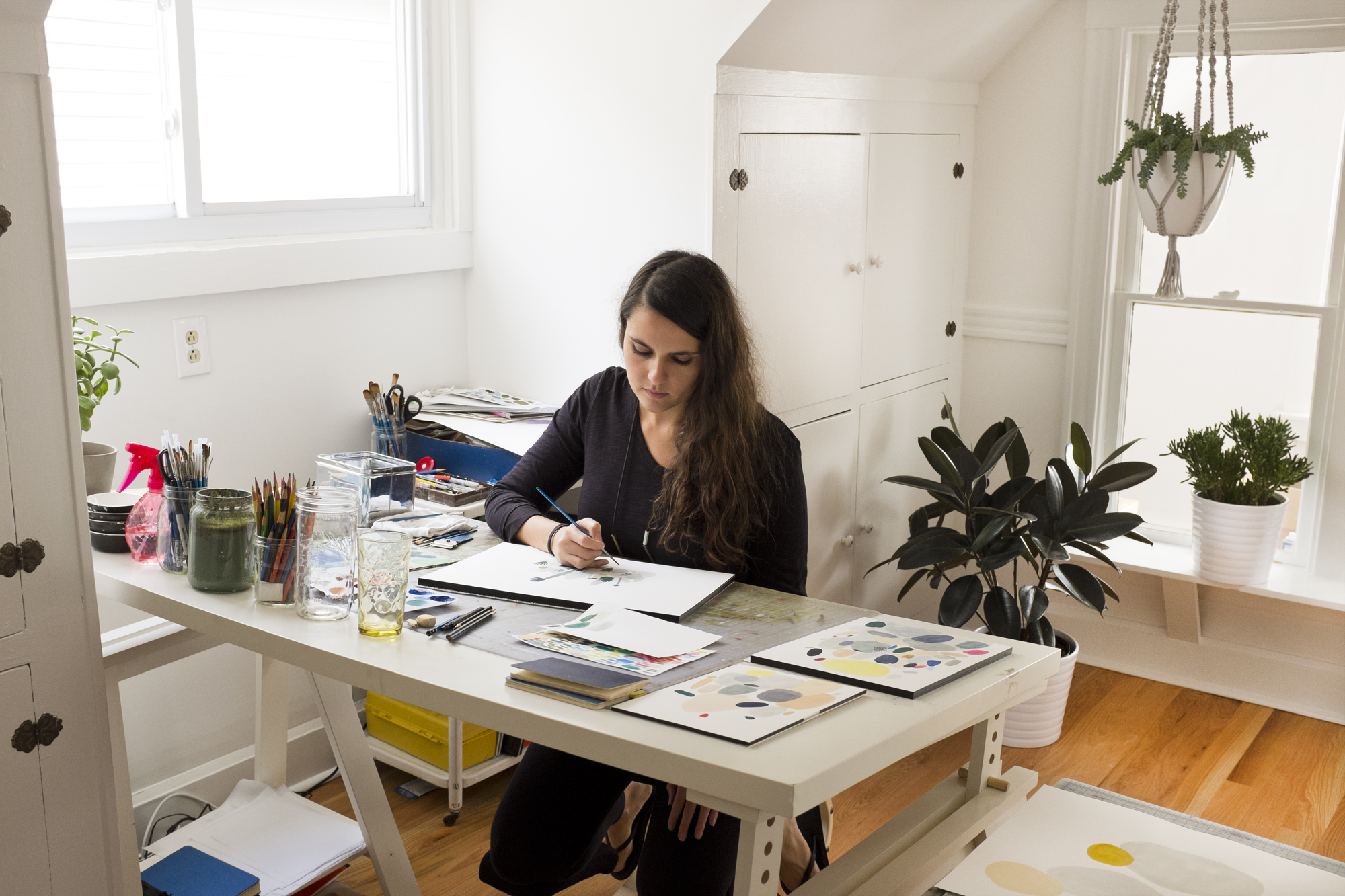 Kate Pugsley working at her desk